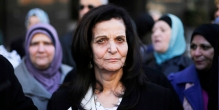 Rasmea Odeh listens to supporters after leaving federal court in Detroit Thursday, March 12, 2015. A judge sentenced the Chicago activist to 18 months in federal prison Thursday for failing to disclose her convictions for bombings in Israel when she applied to be a U.S. citizen. Odeh, 67, also was stripped of her citizenship and eventually will be deported. But she will remain free while she appeals the case. (AP Photo/Paul Sancya)