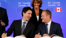 Canadian Prime Minister Justin Trudeau (L) talks with EU Council President Donald Tusk during the signing ceremony of the Comprehensive Economic and Trade Agreement (CETA), at the European Council in Brussels, on October 30, 2016. The EU and Canada finally signed a landmark free trade deal seven years in the making on October 30, 2016, after overcoming last-minute resistance from a small Belgian region that nearly torpedoed the entire agreement. CETA removes 99 percent of customs duties between the two sides, linking the single EU market of 28 nations with the world's 10th largest economy. / AFP / POOL / FRANCOIS LENOIR        (Photo credit should read FRANCOIS LENOIR/AFP/Getty Images)