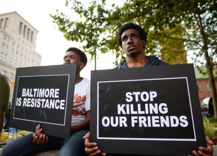 Jacobs and Walloons gather to remember Freddie Gray and all victims of police violence during a rally outside city hall in Baltimore