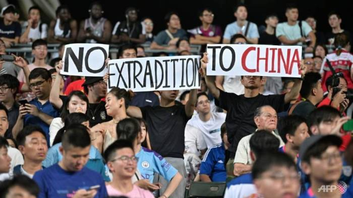 hong-kong-demonstrators-unfurled-banners-and-sang-a-protest-song-during-the-match-which-was-held-after-weeks-of-protests-in-the-city-1563982490193-2